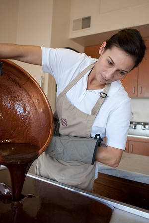 Mike Greene - mgreene@shawmedia.com Kitchen manager Amanda Sheppard, of Lake Geneva, stirs a batch of milk chocolate fudge at Kilwin's Chocolates Tuesday, April 24, 2012 in Lake Geneva. Sheppard, a 19 year employee of the store, enjoys working by the front window and watching customers be drawn in.