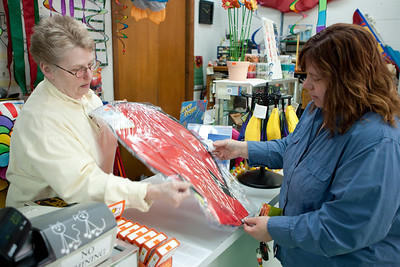 "Mike Greene - mgreene@shawmedia.com Ruth Hackman, owner of Aerial Stunt Kites LLC, helps Trisha Renji, of Elkhorn, with a kite Tuesday, April 24, 2012 at her store in Lake Geneva. Hackman not only sells kites, but offers tips and training to make for a more enjoyable experience. Renji said of the store's service ""It's well worth a little drive down here."""