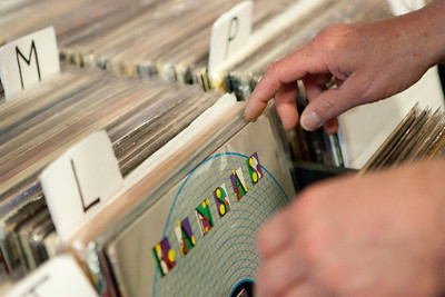 Mike Greene - mgreene@shawmedia.com Tim Townsend, a McHenry native, sorts through vinyl records at Black Circle Records Tuesday, April 24, 2012 in Lake Geneva. The store offers a variety of services including turntable repair as well as buying, selling, and trading records.