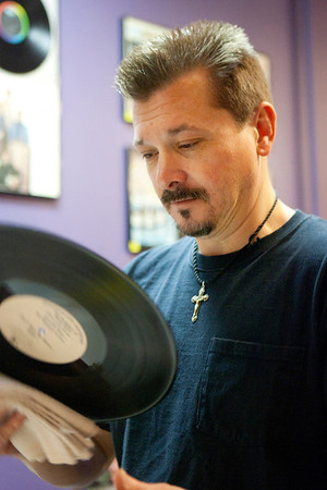 Mike Greene - mgreene@shawmedia.com Tim Townsend, a McHenry native, cleans a vinyl record at Black Circle Records Tuesday, April 24, 2012 in Lake Geneva. The store, owned by McHenry native Tim Townsend, offers a variety of services including album to CD conversion and turntable repairs as well as a collection of vinyl records for sale.