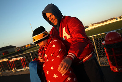 Daniel J. Murphy - dmurphy@shawmedia.com  Brian Dennison of Carpentersville helps Maggie Henson, 17, of Algonquin wrap up at halftime of the Huntley-Jacobs girls soccer game Thursday April 26, 2012 at Huntley High School. Huntley defeated Jacobs in a shootout.