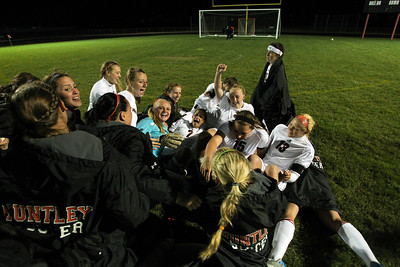 Daniel J. Murphy - dmurphy@shawmedia.com  The Huntley girls soccer team celebrates a win over Jacobs in overtime Thursday April 26, 2012 at Huntley High School.