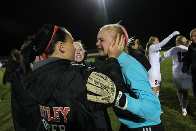 Daniel J. Murphy - dmurphy@shawmedia.com  Huntley players embrace goalkeeper Jessica Galason after defeating Jacobs in a shootout Thursday April 26, 2012 at Huntley High School.