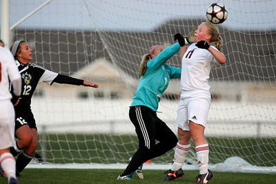 Daniel J. Murphy - dmurphy@shawmedia.com  Huntley goalkeeper Jessica Galason (center) deflects a shot on goal in the first half Thursday April 26, 2012 at Huntley High School. Huntley defeated Jacobs in a shootout.