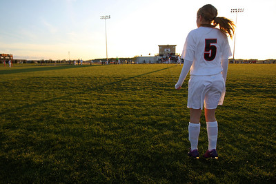 Daniel J. Murphy - dmurphy@shawmedia.com  Huntley midfielder McKenna Moffett jumps on the sideline to stay warm before entering the game Thursday April 26, 2012 at Huntley High School. Huntley defeated Jacobs in a shootout.