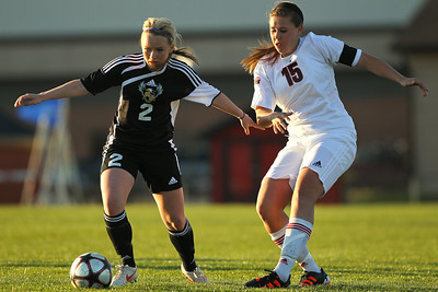 Daniel J. Murphy - dmurphy@shawmedia.com  Jacobs' Kylie Dennison (left) and Huntley defender Rachel Zobott (right) fight for the ball in the first half Thursday April 26, 2012 at Huntley High School. Huntley defeated Jacobs in a shootout.