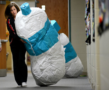Daniel J. Murphy - dmurphy@shawmedia.com  Third grade teacher Gayle Scime carries a giant papier-mâché tube to the gym Saturday April 28, 2012 at Leggee Elementary School in Huntley. On Monday and Tuesday nights next week, Leggee Elementary School will host its annual art show that will feature over 4,000 pieces of artwork created by student artists in Kindergarten through fifth grade.