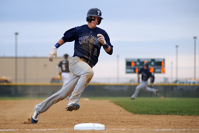 Daniel J. Murphy - dmurphy@shawmedia.com  Cary-Grove's Matt Byrne rounds third base in the fifth inning Friday April 27, 2012 at Jacobs High School. Cary-Grove defeated Jacobs 3-1.
