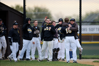 Daniel J. Murphy - dmurphy@shawmedia.com  The Jacobs' dugout clears to embrace Connor Conzelman after scoring an inside-the-park home run Friday April 27, 2012 at Jacobs High School. Cary-Grove defeated Jacobs 3-1.
