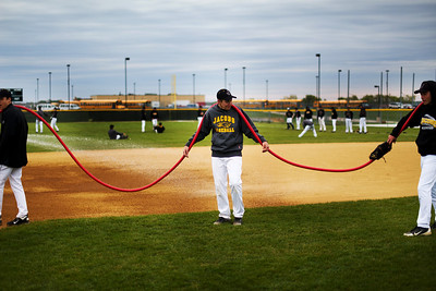 Daniel J. Murphy - dmurphy@shawmedia.com  Members of the Jacobs baseball team water down the field before the start of their game against Cary-Grove Thursday April 26, 2012 at Huntley High School. Huntley defeated Jacobs in a shootout.