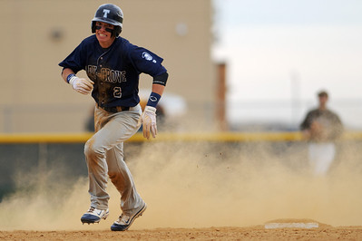 Daniel J. Murphy - dmurphy@shawmedia.com  Cary-Grove's Matt Byrne rounds second base in the fifth inning Friday April 27, 2012 at Jacobs High School. Cary-Grove defeated Jacobs 3-1.