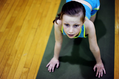 Sarah Nader - snader@shawmedia.com Ellie Landoch, 7, of Cary stretches out while participating in a kids yoga class during Healthy Kids Day at The Sage YMCA in Crystal Lake on Saturday, April 28, 2012. The event was geared towards creating a healthy lifestyle and featured games, dance and XBox kinect contests, family Zumba, Healthy Kid seminars with local health experts and healthy snacks.
