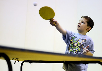 Sarah Nader - snader@shawmedia.com Jake Rugg, 6, of Island Lake plays table tennis during Healthy Kids Day at The Sage YMCA in Crystal Lake on Saturday, April 28, 2012.