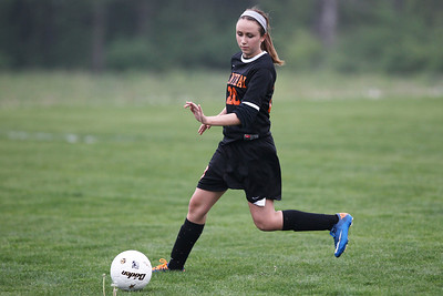 Mike Greene - mgreene@shawmedia.com Crystal Lake Central's Kyra Savage tracks down the ball during a game against Hampshire Monday, April 30, 2012 in Hampshire. Crystal Lake Central won the game 3-0.