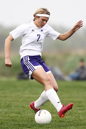 Mike Greene - mgreene@shawmedia.com Hampshire's Elizabeth Panzica kicks the ball backwards with her heel during a game against Crystal Lake Central Monday, April 30, 2012 in Hampshire. Crystal Lake Central won the game 3-0.