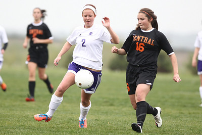 Mike Greene - mgreene@shawmedia.com Hampshire's Dakota Walther and Crystal Lake Central's Brittany Bromfield fight for a ball during a game Monday, April 30, 2012 in Hampshire. Crystal Lake Central won the game 3-0.