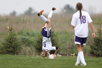 Mike Greene - mgreene@shawmedia.com Hampshire's Helena VanEck does a flip while throwing a ball in on offense during a game against Crystal Lake Central Monday, April 30, 2012 in Hampshire. Crystal Lake Central won the game 3-0.