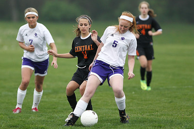 Mike Greene - mgreene@shawmedia.com Hampshire's Jessica Boutin tries to keep the ball away from Crystal Lake Central's Stacey Wolfgram during a game Monday, April 30, 2012 in Hampshire. Crystal Lake Central won the game 3-0.