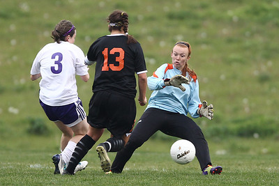 Mike Greene - mgreene@shawmedia.com Hampshire's goalkeeper, Haylee Moscato, gets caught on her heels as Crystal Lake Central's Madie Edwards (13) dribbles past during a game Monday, April 30, 2012 in Hampshire. Edwards scored on the attack and Crystal Lake Central won the game 3-0.