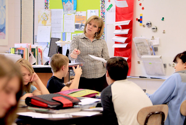 Sandy Bressner - sbressner@shawmedia.com<br /> Amy Pifer teaches her eighth grade literature class at Kaneland Harter Middle School in Sugar Grove Tuesday afternoon.