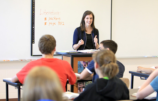 Sandy Bressner - sbressner@shawmedia.com<br /> Cassie Sauber teaches her eighth grade literature class at Kaneland Harter Middle School in Sugar Grove Tuesday afternoon.