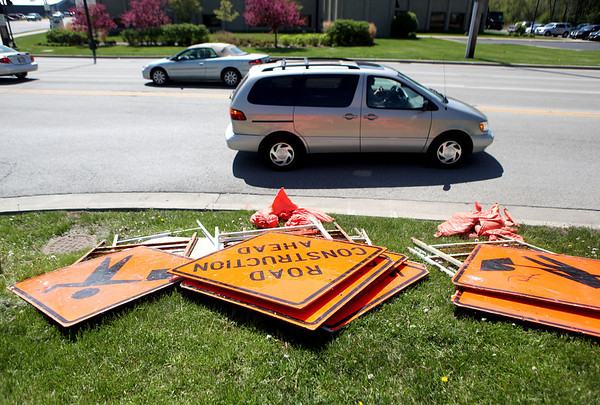 Sandy Bressner - sbressner@shawmedia.com<br /> Construction signs lay on the grass on Dean Street, just west of Randall Road in St. Charles.
