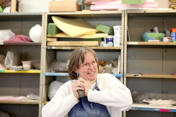 Sandy Bressner - sbressner@shawmedia.com<br /> Nancy Hart of Batavia works with clay in her sculpture class at the Fine Line Creative Arts Center in St. Charles. The center is hosting a fundraiser to expand their facility April 20.