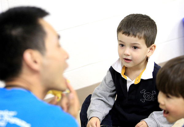 Sandy Bressner - sbressner@shawmedia.com<br /> William Li teaches Mandarin Chinese to Landon Fanale, 4, (left) of Geneva and Will Behan, 5, of St. Charles at Language Stars, which operates out of the Congregational United Church of Christ in St. Charles.