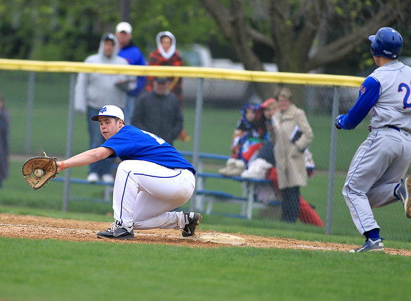 Sandy Bressner - sbressner@shawmedia.com<br /> Geneva first baseban Anthony Bragg gets Marmion's Connor Medernach out at first during their game at Geneva Friday.