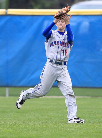 Sandy Bressner - sbressner@shawmedia.com<br /> Mike Pipp of Marmion Academy catches a ball in right field during their game at Geneva Friday.
