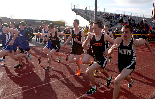 Sandy Bressner - sbressner@shawmedia.com<br /> St. Charles East and Geneva boys take off for the 800-meter run during a dual co-ed track and field meet at St. Charles East Tuesday.