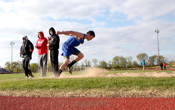 Sandy Bressner - sbressner@shawmedia.com<br /> Justin Nebel of Geneva competes in the triple jump during a dual co-ed track and field meet at St. Charles East Tuesday.