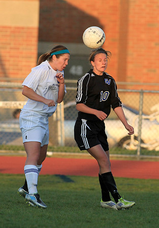 Sandy Bressner - sbressner@shawmedia.com<br /> Geneva's Amanda Lulek (right) and St. Charles North's Kenzie Rose head the ball during their game Tuesday at North.