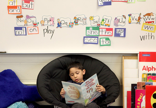Sandy Bressner - sbressner@shawmedia.com<br /> Adrian Vargas reads a story to himself in his kindergarten classroom Tuesday at Kaneland McDole Elementary School in Montgomery.