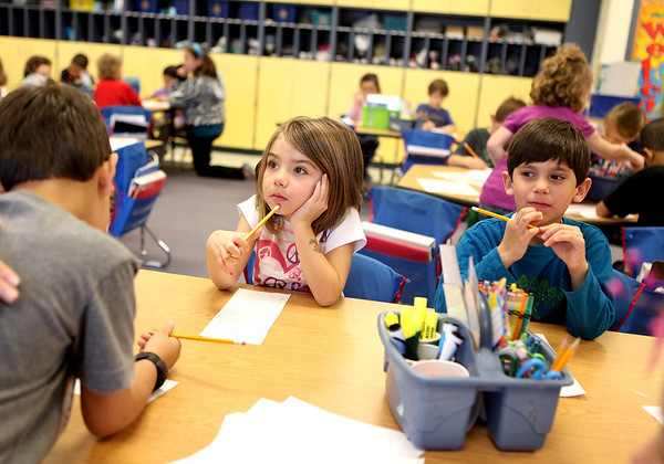 Sandy Bressner - sbressner@shawmedia.com<br /> Kindergartner Gianna Walgren concentrates while working on a project with classmates Ian Stein (right) and Jace Mires (left) Tuesday at Kaneland McDole Elementary School in Montgomery.