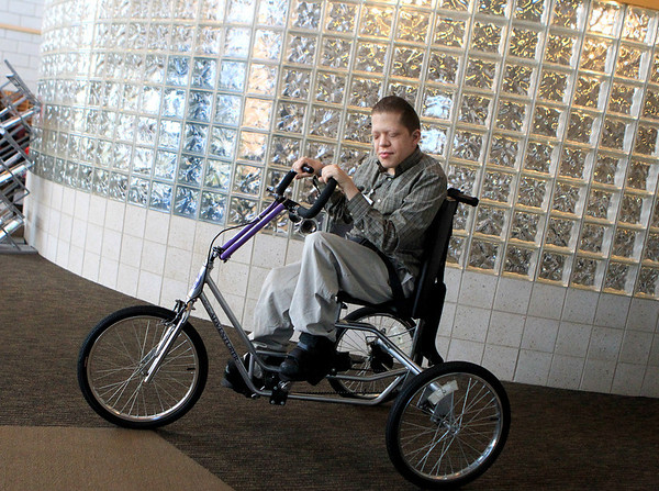 Sandy Bressner - sbressner@shawmedia.com<br /> Clint K., a client at Marklund at Mill Creek in Geneva, rides his bicycle through the halls of the facility.