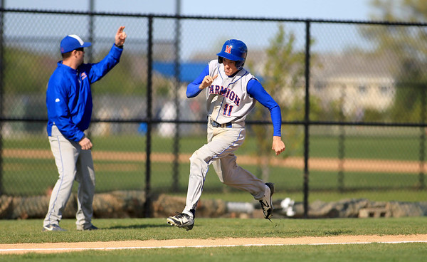 Marmion's Mike Pipp runs home during their home game against St. Francis Monday.