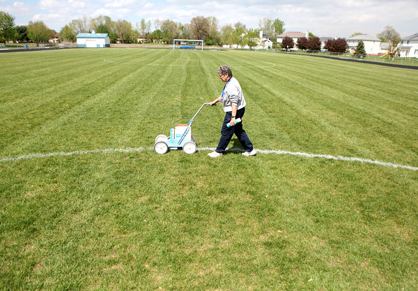 Sandy Bressner - sbressner@shawmedia.com<br /> Rosary High School Athletic Director Mary Lou Kunold paints the soccer field Tuesday afternoon. Kunold has been teaching and coaching at the Aurora school since 1973 and started the athletic program.