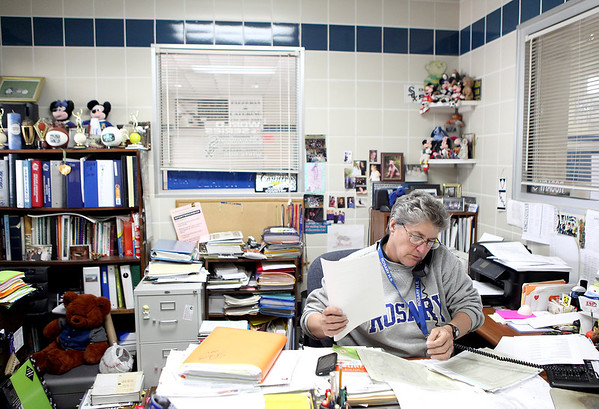 Sandy Bressner - sbressner@shawmedia.com<br /> Rosary High School Athletic Director Mary Lou Kunold takes a call in her office Tuesday afternoon. Kunold has been teaching and coaching at the Aurora school since 1973 and started the athletic program.