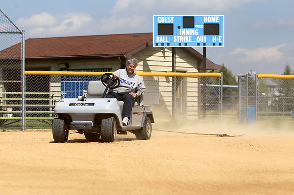 Sandy Bressner - sbressner@shawmedia.com<br /> Rosary High School Athletic Director Mary Lou Kunold drags the softball field Tuesday afternoon. Kunold has been teaching and coaching at the Aurora school since 1973 and started the athletic program.