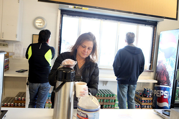 Sandy Bressner - sbressner@shawmedia.com<br /> Donna Ranieri prepares hot chocolate in the concession area at St. Charles North High School during a varsity girls soccer game Tuesday. Ranieri is a member of the girls soccer booster club at the school.