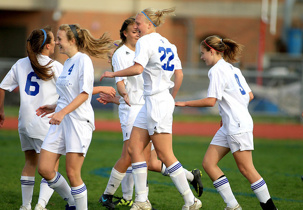 Sandy Bressner - sbressner@shawmedia.com<br /> St. Charles North's Sophie Pohl (22) celebrates her goal with her teammates in the first half of their home game against Batavia Tuesday.