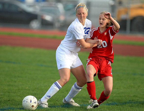 Sandy Bressner - sbressner@shawmedia.com<br /> St. Charles North's Sophie Pohl (left) and Batavia's Shelby Stone battle for possession during their game at North Tuesday.