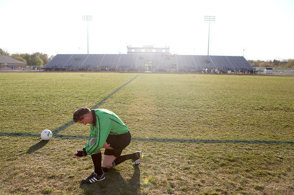 Sandy Bressner - sbressner@shawmedia.com<br /> Gene Mroz of Geneva prepares to referee a varsity girls soccer game at St. Charles North High School Monday evening.