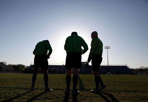 Sandy Bressner - sbressner@shawmedia.com<br /> Gene Mroz of Geneva (center) prepares to referee a varsity girls soccer game at St. Charles North High School with George Ghawi of St. Charles (left) and Dylan Kramer of Elmhurst (right) Monday evening.