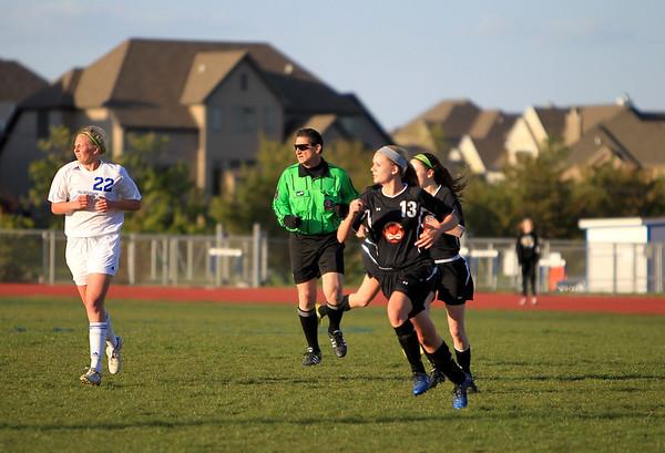 Sandy Bressner - sbressner@shawmedia.com<br /> Gene Mroz of Geneva officiates a varsity girls soccer game at St. Charles North High School Monday evening.