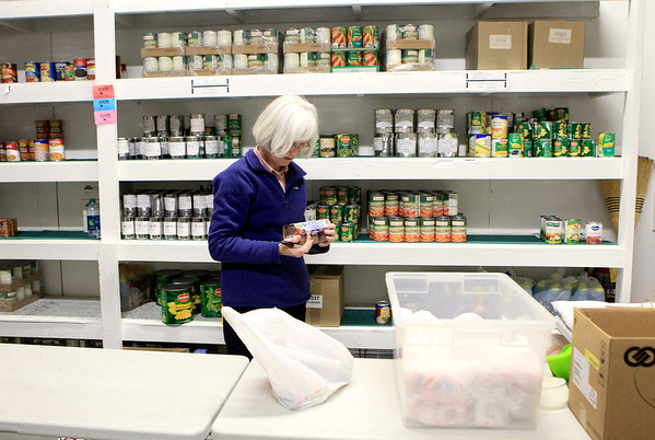 Sandy Bressner - sbressner@shawmedia.com<br /> Volunteer Mary Ochsenschlager of Sugar Grove sorts food at the Between Friends Food Pantry in Sugar Grove Thursday afternoon.