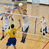 St. Charles North's Jack Bujko (14) and Johnathan Orech (2) go for a block attempt against Joliet East during the West Aurora Boys Varsity Volleyball Invite at West Aurora High School in Aurora, IL on Saturday, March 30, 2013 (Sean King for The Kane County Chronicle)