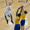 St. Charles North's Johnathan Orech (2) goes up for a kill against Joliet East during the West Aurora Boys Varsity Volleyball Invite at West Aurora High School in Aurora, IL on Saturday, March 30, 2013 (Sean King for The Kane County Chronicle)