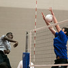 Geneva's Nick Buseki (30) blocks a kill attempt by Oswego East's Justice McGhee during the West Aurora Boys Varsity Volleyball Invite at West Aurora High School in Aurora, IL on Saturday, March 30, 2013 (Sean King for The Kane County Chronicle)